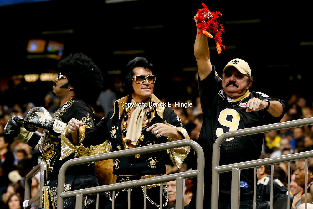 Sep 22, 2013; New Orleans, LA, USA; New Orleans Saints fans in the stands during a game against the Arizona Cardinals at Mercedes-Benz Superdome. The Saints defeated the Cardinals 31-7. Mandatory Credit: Derick E. Hingle-USA TODAY Sports