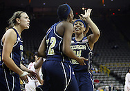 24 MARCH 2009: Georgia Tech forward Chelsea Regins (32) and Georgia Tech guard/forward Iasia Hemingway (34) celebrate after a play during an NCAA Women's Tournament basketball game Tuesday, March 24, 2009, at Carver-Hawkeye Arena in Iowa City, Iowa. Oklahoma defeated Georgia Tech 69-50.