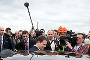© Licensed to London News Pictures. 13/04/2015. Carshalton, UK. Nick Clegg is ushered to his car by his police officers. Tom Brake and Nick Clegg (R) arrive outside St Helier Hospital to talk to supporters. Leader of the Liberal Democrats and Deputy Prime Minister Nick Clegg visits Carshalton and Wallington constituency on Monday (13th April) with Lib Dem candidate Tom Brake.  Photo credit : Stephen Simpson/LNP