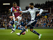 Joleon Lescott and Leandro Bacuna during the The FA Cup match between Aston Villa and West Bromwich Albion at Villa Park, Birmingham, England on 7 March 2015. Photo by Adam Rivers.