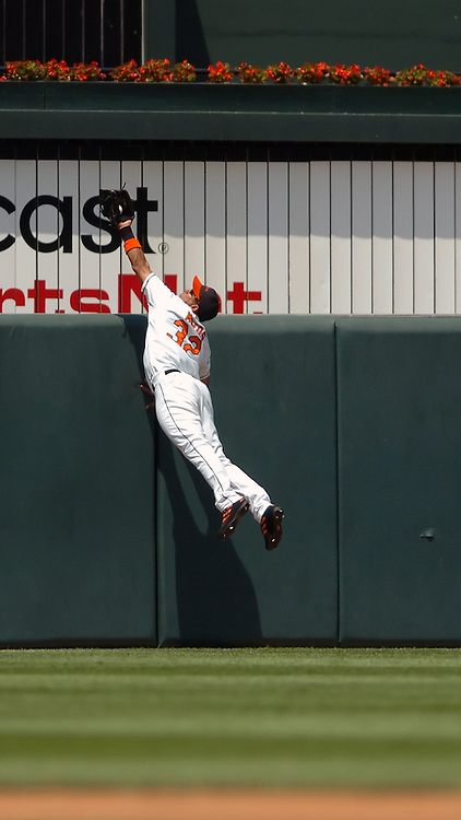 9 July 2005: Baltimore Orioles center fielder Luis Matos makes a leaping catch at the wall to rob Boston Red Sox designated hitter David Ortiz of a home run in game won by the Orioles 9-1 at Orioles Park at Camden Yards in Baltimore, MD.