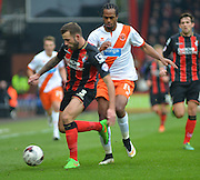AFC Bournemouth's Steve Cook on the ball during the Sky Bet Championship match between Bournemouth and Blackpool at the Goldsands Stadium, Bournemouth, England on 14 March 2015. Photo by Mark Davies.