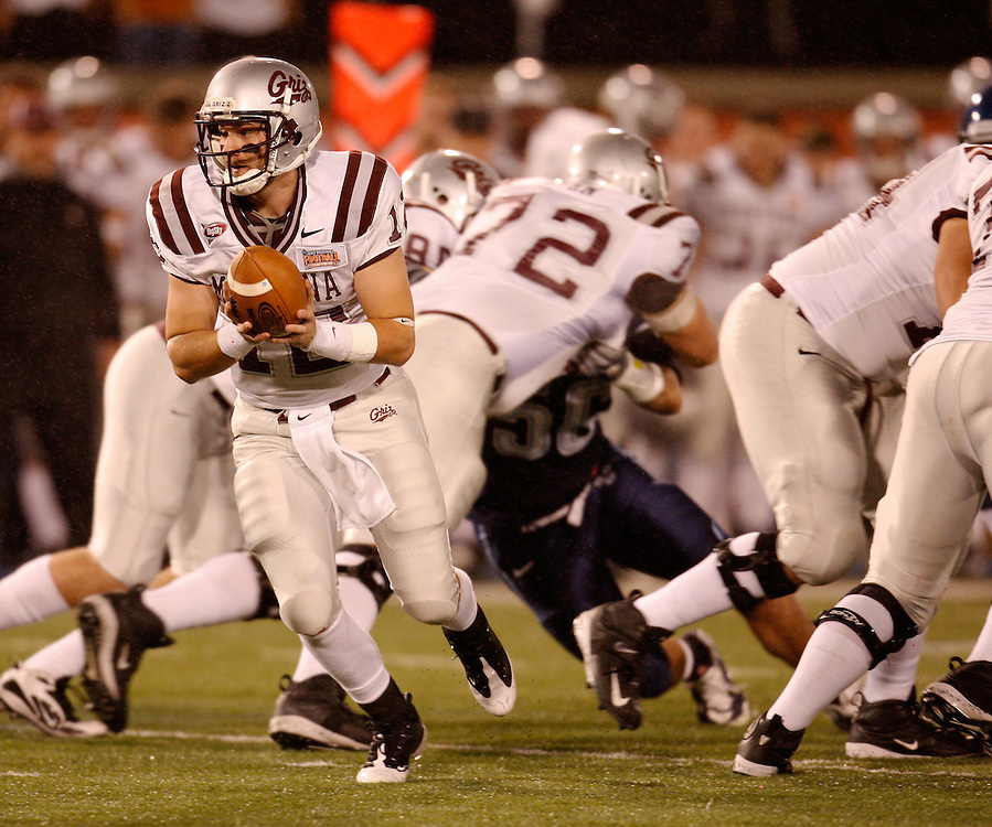 CHATTANOOGA, TN - DECEMBER 18:  Quarterback Andrew Selle #12 of the Montana Grizzlies looks to hand the ball off in the backfield during the NCAA FCS Championship game against the Villanova Wildcats at Finley Stadium on December 18, 2009 in Chattanooga, Tennessee.  The Wildcats beat the Grizzlies 23-21.  (Photo by Mike Zarrilli/Getty Images)