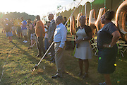 Ohio University President Roderick McDavis watches the Ohio University Marching Band perform for the Black Alumni Reunion during its welcome reception at Tailgreat Park on Thursday, September 15, 2016.