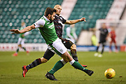 Darren McGregor is tracked by Curtis Main during the Ladbrokes Scottish Premiership match between Hibernian and Motherwell at Easter Road, Edinburgh, Scotland on 31 January 2018. Picture by Kevin Murray.
