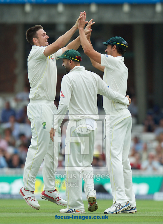 Bowler Mitchell Marsh of Australia(left) celebrates taking the wicket of Jos Buttler of England during the 5th Investec Ashes Test match at the Kia Oval, London<br /> Picture by Alan Stanford/Focus Images Ltd +44 7915 056117<br /> 23/08/2015