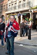 PRINCE PHILIP ROYAL MASKS OUTSIDE A PUB, The Royal Wedding of Prince William and  Catherine Middleton. Scenes around Buckingham Palace and the Mall.   London. 29 April 2011. , -DO NOT ARCHIVE-© Copyright Photograph by Dafydd Jones. 248 Clapham Rd. London SW9 0PZ. Tel 0207 820 0771. www.dafjones.com.