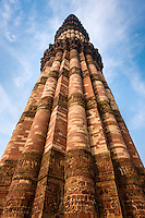 NEW DELHI, INDIA - CIRCA OCTOBER 2016: Minaret at the Qutub Minar complex. With 73 metres, is the tallest brick minaret in the world and second highest minar in India, a popular tourist attraction and Unesco World Heritage Site.