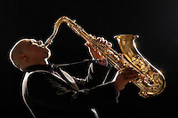 Man Playing Saxophone side view