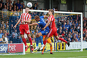 Sunderland defender Donald Love (18) beating AFC Wimbledon striker James Hanson (18) to the ball during the EFL Sky Bet League 1 match between AFC Wimbledon and Sunderland at the Cherry Red Records Stadium, Kingston, England on 25 August 2018.