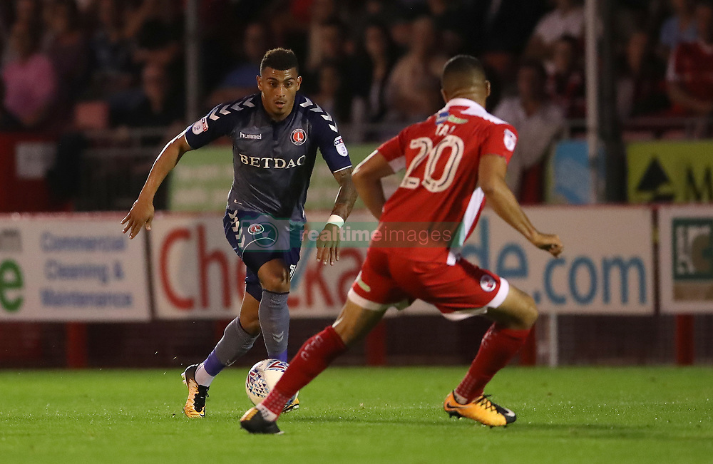 Charlton Athletic's Karlan Ahearne-Grant (left) and Crawley Town's Aryantaj Tajbakhsh battle for the ball