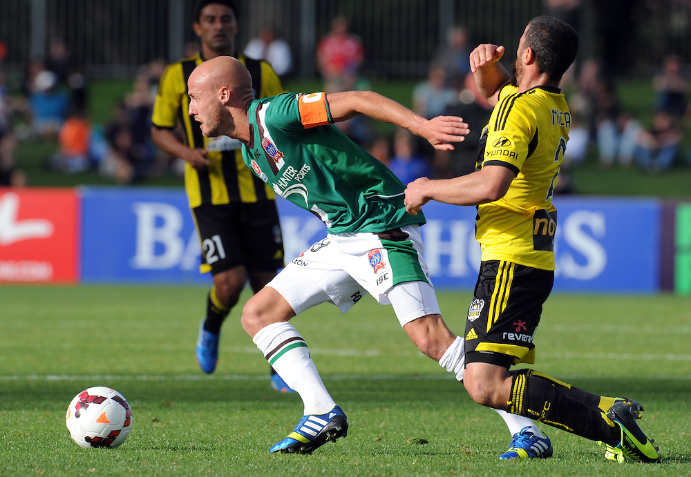 Newcastle Jets' Ruben Zadkovich, left, pushes off Phoenixs' Manny Muscat in the A-League football match at McLean Park, Napier, New Zealand, Sunday, October 27, 2013. Credit:SNPA / Ross Setford