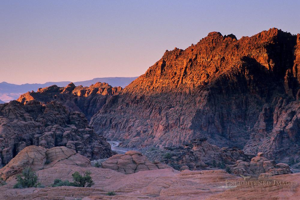 Sunrise light on red sandstone peaks in Snow Canyon State Park, Ivins, Utah's Dixie, near St. George, UTAH