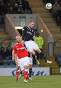 Dundee's James McPake heads clear from Ross County's Liam Boyce - Dundee v Ross County, SPFL Premiership at Dens Park<br /> <br />  - &copy; David Young - www.davidyoungphoto.co.uk - email: davidyoungphoto@gmail.com