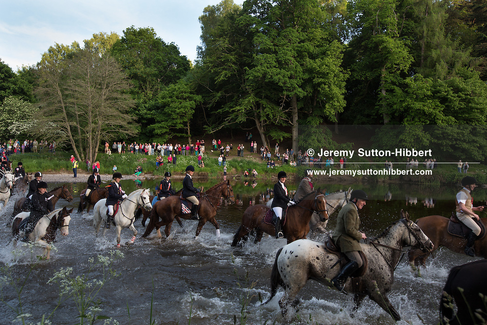 Viewing the horses crossing the River Tweed during the Riding of the Marches, at The Peebles Beltane Festival, including their Common Riding of the Marches, with Cornet Daniel Williamson, and Cornets Elect Lass Susan Thomson, in Peebles, Scotland, Wednesday 19th June 2013. <br /> N55&deg;39.057'<br /> W3&deg;12.394'