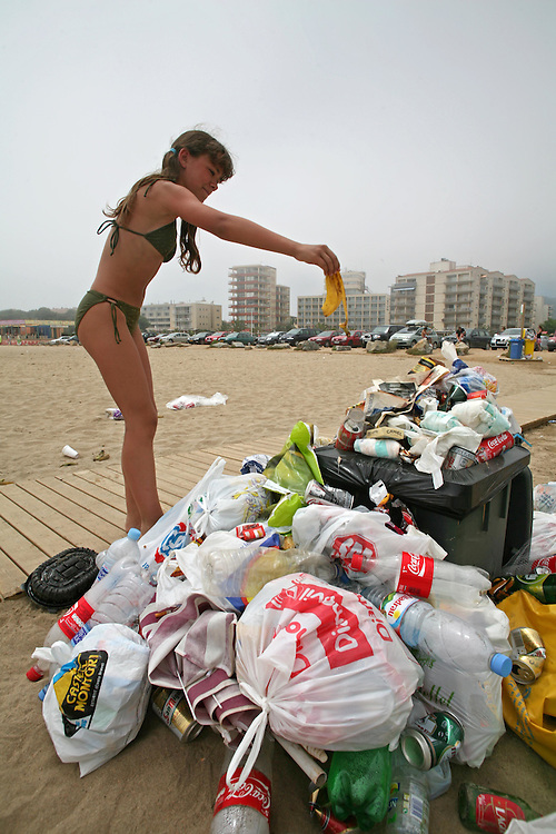 Amount of accumulated garbage in the containers of a tourist locality of the Costa Brava due to the strike of garbage pickers. The tourists coexist with the full waste baskets and the bad stinks..L'Estartit (Costa Brava. Catalonia. Spain).