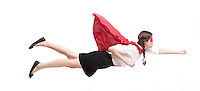 Young Asian woman in superhero costume in flying pose against white background