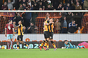 Jake Livermore of Hull City celebrates his goal with Hull City midfielder David Meyler and Hull City striker Abel Hernandez to go 1-0 up  during the Sky Bet Championship match between Hull City and Burnley at the KC Stadium, Kingston upon Hull, England on 26 December 2015. Photo by Ian Lyall.