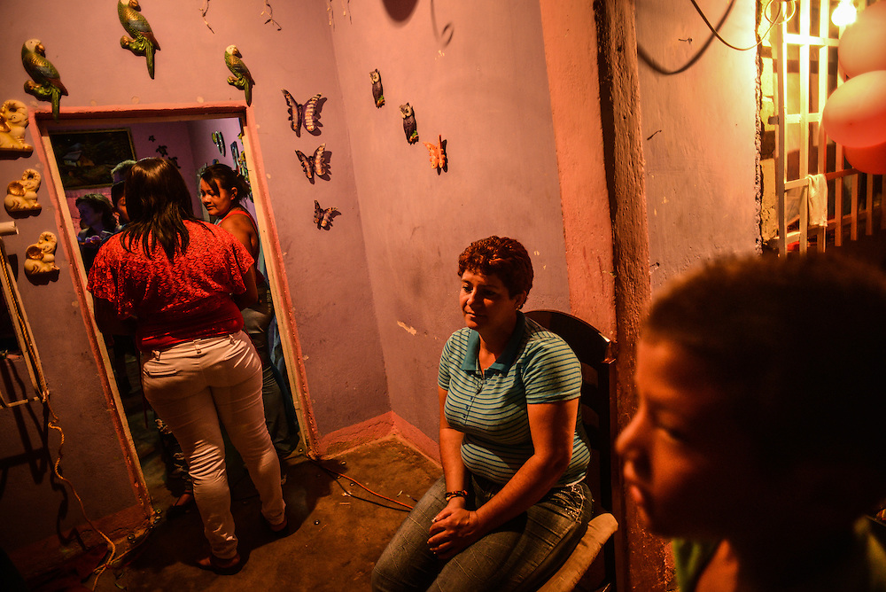 "Members of the Barrios family celebrate a birthday at a family home in Cagua, Venezuela. Nine men in the Barrios family have been murdered by the police. The party was largly attended by female family members -- when asked why, several women said in union, ""because there aren't any men left."""