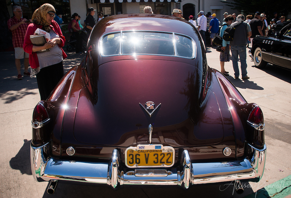 Spectators enjoy classic cars in downtown Carmel, seen at the Carmel-by-the-Sea Concours on the Avenue event during Monterey Car Week