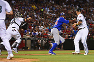 PHOENIX, ARIZONA - APRIL 08:  Dexter Fowler #24 of the Chicago Cubs gets caught in an inning ending double play in the fifth inning against the Arizona Diamondbacks at Chase Field on April 8, 2016 in Phoenix, Arizona.  (Photo by Jennifer Stewart/Getty Images)