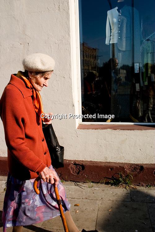 Stylish elderly Polish women walking to market on a traditional shopping trip.  Lodz Central Poland