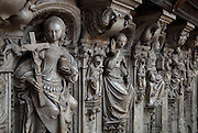 Statue of Charity (left) on the tomb of the Cardinals of Amboise, 1515-25, by Roullant Le Roux and Pierre des Aubeaux in Renaissance style, in Rouen Cathedral or the Cathedrale de Notre Dame de Rouen, built 12th century in Gothic style, with work continuing through the 13th and 14th centuries, Rouen, Normandy, France. The tomb has 2 praying figures of Cardinal Georges d'Amboise, died 1510, archbishop of Rouen, and his nephew Georges II d'Amboise, died 1550, also archbishop and cardinal. Below are 6 statues representing faith, charity, prudence, power, justice and temperance. Picture by Manuel Cohen