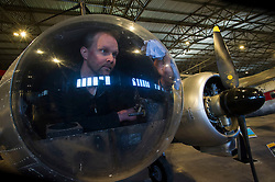 Pictured: Aircraft conservator Thilo Burgel helps maintain an 1947 Avro Anson<br /> <br /> The redeveloped National Museum of Flight at East Fortune has undergone a  £3.6 million refurbishment and now has aeroplanes including a Spitfire, a Harrier Jump Jet and a Tornado T-3 on display.    (c) Ger Harley, EEm 22 March 2016