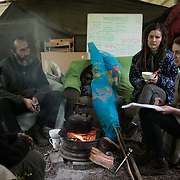 Life in the Save Leith Hill camp in Coldharbour Lane. Constance Whiston, a defendant in the super injunction brought on by UKOG, practicing her upcoming talk in Dorking. Europa Oil and Gas company has got license to drill for oil in the woods near Leith Hill.  Proetctors of the land, a group of local campaigners against the proposed drilling and activists have set up a community camp on Coldharbour Lane to  protect Leith Hill from the unconventional oil exploration, through monitoring, awareness raising, and peaceful community action.