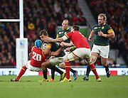 South Africa's Handre Pollard getting tackled by Wales Justin Tipuric during the Rugby World Cup Quarter Final match between South Africa and Wales at Twickenham, Richmond, United Kingdom on 17 October 2015. Photo by Matthew Redman.