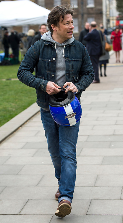 © Licensed to London News Pictures. 16/03/2016. London, UK. Celebrity chef JAMIE OLIVER carrying a bike helmet In Westminster on the day that George Osborne announced a sugar tax in his budget. Photo credit: Ben Cawthra/LNP