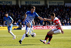 Lewis Hawkins of Hartlepool United takes on Tommy Rowe of Doncaster Rovers - Mandatory by-line: Robbie Stephenson/JMP - 06/05/2017 - FOOTBALL - The Northern Gas and Power Stadium (Victoria Park) - Hartlepool, England - Hartlepool United v Doncaster Rovers - Sky Bet League Two