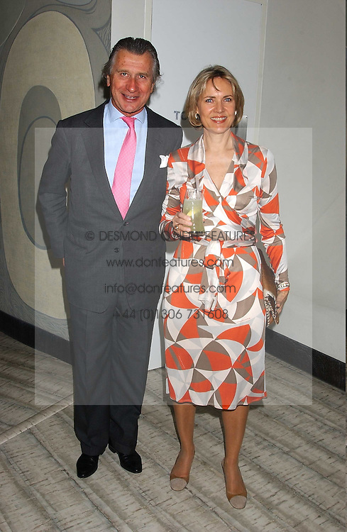 ARNAUD BAMBERGER and his wife CARLA at a dinner hosted by Arnaud Bamber MD of Cartier, Amanda Sharp and Matthew Slotover Directors of the Frieze Art Fair to celebrate artists featured in the 2005 Frieze Art Fair Curatorial Programme at Nobu-Berkeley, 15th Berkeley Street, London on 21st October 2005.<br /><br />NON EXCLUSIVE - WORLD RIGHTS