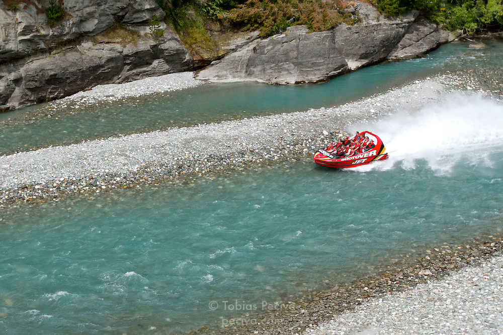 Tourists jetboating the Shotover River with Shotover Jet.