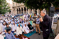 Roma 17  Luglio 2015<br /> Gli immigrati musulmani affollano Piazza Vittorio, a Roma, per la preghiera di Eid al-Fitr che segna la fine del mese di digiuno del Ramadan. Don Matteo Zuppi, vescovo ausiliare  porta il saluto della diocesi di Roma.<br /> Roma 17 July 2015<br /> Muslim immigrants crowd the garden of Piazza Vittorio, in Rome's Esquilino multi-ethnic quarter, for the Eid al-Fitr prayer to mark the end of the fasting month of Ramadan. Don Matteo Zuppi, auxiliary bishop  brings greetings  of the Diocese of Rome.
