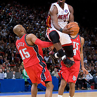 9 October 2008: Dwyane Wade of the Miami Heat goes to the basket against Vince Carter of the New Jersey Nets during the New Jersey Nets 100-98 overtime victory over the Miami Heat in an exhibition game at Bercy Arena, in Paris, France.