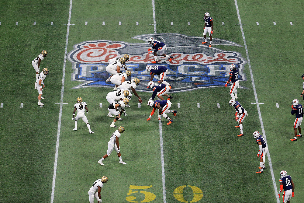 The Auburn Tigers and the UCF Knights line up during the 2018 Chick-fil-A Peach Bowl NCAA football game on Monday, January 1, 2018 in Atlanta. (Daniel Shirey / Abell Images for the Chick-fil-A Peach Bowl)
