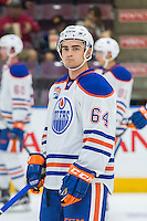 PENTICTON, CANADA - SEPTEMBER 17: Thomas Foster #64 of Edmonton Oilers stands on the ice during warm up against the Calgary Flames on September 17, 2016 at the South Okanagan Event Centre in Penticton, British Columbia, Canada.  (Photo by Marissa Baecker/Shoot the Breeze)  *** Local Caption *** Thomas Foster;