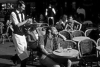 at a Parisian terrace cafe - Photograph by Owen Franken