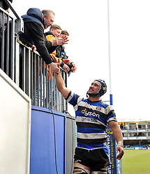 Leroy Houston of Bath Rugby shakes supporters' hands after the match - Photo mandatory by-line: Patrick Khachfe/JMP - Mobile: 07966 386802 25/01/2015 - SPORT - RUGBY UNION - Bath - The Recreation Ground - Bath Rugby v Glasgow Warriors - European Rugby Champions Cup