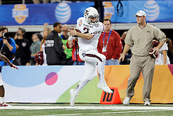 Texas A&M Quarterback Johnny Manziel (2) tip toes the sideline while staying in bounds for the first of his two rushing touchdowns of the 77th AT&T Cotton Bowl Classic between the Texas A&M University Aggies and the Oklahoma University Sooners at Cowboys Stadium in Arlington, Texas. Texas A&M wins the 77th AT&T Cotton Bowl Classic against Oklahoma, 41-13.