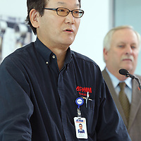 Hidehiro Kuwabra, President of APMM, Auto Parts Manufacturing Mississippi, speaks on the $100 million expanison of his plant in Guntown on Tuesday morning.