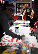 MADISON, WI – MARCH 27: Protestors Ali Brooks, right, and Brandi Grayson, left, design protest signs at the UW South Madison Partnership space in advance of Presidential candidate Donald Trump's visit to Janesville, Wisconsin.