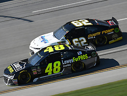October 14, 2018 - Talladega, AL, U.S. - TALLADEGA, AL - OCTOBER 14: Jimmie Johnson, Hendrick Motorsports, Chevrolet Camaro Lowe's for Pros (48) races side by side with Brendan Gaughan, Beard Motorsports, Chevrolet Camaro Beard Oil Distributing / South Point Hotel & Casino (62) during the 1000Bulbs.com 500 on October 14, 2018, at Talladega Superspeedway in Tallageda, AL.(Photo by Jeffrey Vest/Icon Sportswire) (Credit Image: © Jeffrey Vest/Icon SMI via ZUMA Press)