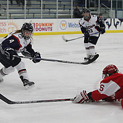 Sammy Davis, (right), Boston University, shoots past Cydnee Cook, UConn, during the UConn Vs Boston University, Women's Ice Hockey game at Mark Edward Freitas Ice Forum, Storrs, Connecticut, USA. 5th December 2015. Photo Tim Clayton