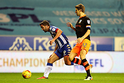 Glenn Loovens of Sheffield Wednesday tackles Will Grigg of Wigan Athletic - Mandatory by-line: Matt McNulty/JMP - 03/02/2017 - FOOTBALL - DW Stadium - Wigan, England - Wigan Athletic v Sheffield Wednesday - Sky Bet Championship