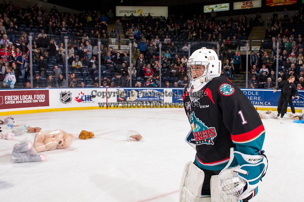 KELOWNA, CANADA - DECEMBER 1:  James Porter #1 of the Kelowna Rockets skates to the bench as teddy bears are cleared from the ice against the Saskatoon Blades on December 1, 2018 at Prospera Place in Kelowna, British Columbia, Canada.  (Photo by Marissa Baecker/Shoot the Breeze)