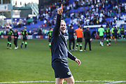Forest Green Rovers assistant manager, Scott Lindsey applauds the fans at the end of the match during the EFL Sky Bet League 2 match between Tranmere Rovers and Forest Green Rovers at Prenton Park, Birkenhead, England on 19 April 2019.