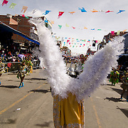 An angel costume and performers at Carnival in Oruro, Bolivia.