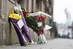 Westminster, London, March 23rd 2017. A card written mainly in Arabic says 'Not in my name' amongst bouquets laid on Whitehall as investigations continue following Tuesday's terrorist attack on Westminster Bridge and in the grounds of Parliament, in which four people and their attacker were killed with over 40 injured.